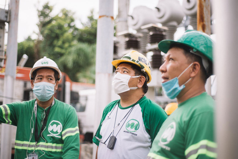 Roel Z Castro together with MORE Power engineers during the launch of 69kV switching station at Banuyao, Lapaz.
